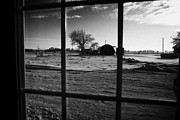Sask Prints - looking out through door window to snow covered scene in small rural village of Forget Saskatchewan  Print by Joe Fox