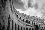 Ancient Rome Art - Looking Up At Blue Cloudy Sky And Upper Tiers Of The Old Roman Colloseum At El Jem Tunisia by Joe Fox