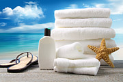 Health Resort Prints - Lotion  towels and sandals with ocean scene Print by Sandra Cunningham