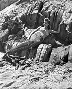 Mermaids Photos - Lounging Mermaid On The Rocks by Underwood Archives