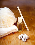 Absorbent Posters - Luxury bath or shower set with towel sponge perfume and shells on wooden table Poster by Gino De Graaf