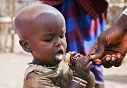 Maasai Child Trying To Eat A Lollipop In Tanzania Print by Michal Bednarek
