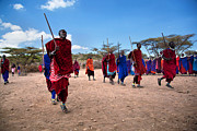 East Village Photos - Maasai men in their ritual dance in their village in Tanzania by Michal Bednarek