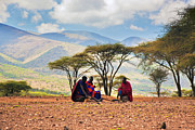Apparel Posters - Maasai men sitting. Savannah landscape in Tanzania Poster by Michal Bednarek