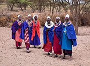 House Portrait Prints - Maasai women in front of their village in Tanzania Print by Michal Bednarek