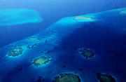 Jenny Rainbow - Maldivian Reefs. Aerial Journey Over Maldivian Archipelago