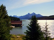 Water Reflections Photos - Maligne Lake Boathouse by Karen Wiles