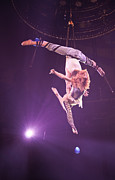 Shirtless Photos - Man and Woman on Trapeze at Paris Circus  by Matthew Bamberg