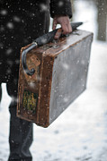 Evacuee Prints - Man Holding A Vintage Leather Suitcase In Winter Snow Print by Lee Avison