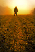 Trench Coat Framed Prints - Man in field at sunset Framed Print by Edward Fielding