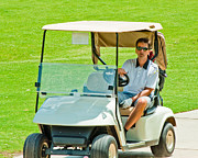 Sports Pyrography Prints - Man in golf cart Print by Brett Price