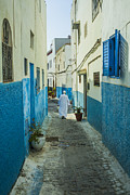 Rabat Prints - Man in white djellaba walking in medina of Rabat Print by Patricia Hofmeester