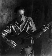 Guitar Player Photos - MAN PLAYING GUITAR in a DARK ROOM - 1930 by Daniel Hagerman