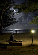 Sea Moon Full Moon Photo Posters - Man sitting watching the full moon at the beach Poster by Dray Van Beeck