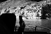Cellphone Photo Prints - man taking photos with smartphone during boat ride along the colorado river in the grand canyon Ariz Print by Joe Fox