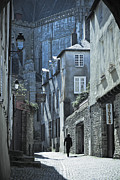 Archetypal Posters - Man walking away down an ancient old medieval street in Vannes Brittany France Europe Poster by Jon Boyes