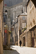 Archetypal Photo Prints - Man walking away down an ancient old medieval street in Vannes Brittany France Print by Jon Boyes
