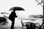 North Vancouver Framed Prints - man with backpack and umbrella walking hurrying in the rain north Vancouver BC Canada deliberate mot Framed Print by Joe Fox