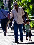 Man With Boy In Sao Paulo Print by Julie Niemela