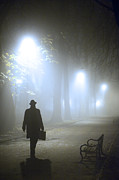 Mysterious Stranger Framed Prints - Man With Briefcase Walking On A Foggy Avenue At Night In Winter Framed Print by Lee Avison
