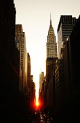 New York City Skyline Framed Prints - Manhattanhenge Sunset and the Chrysler Building  Framed Print by Vivienne Gucwa
