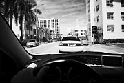 Collins Avenue Prints - Mans Hand On Wheel Driving Along Collins Ave In Miami South Beach Following A Yellow Cab Florida Usa Print by Joe Fox