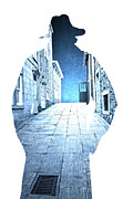 Man Photo Prints - Mans profile silhouette with old city streets Print by Edward Fielding