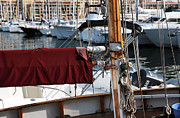 Docked Sailboat Prints - Maroon Sail  Print by John Rizzuto