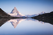 Matterhorn Prints - Matterhorn reflected in Riffelsee lake at sunrise Zermatt Switzerland Print by Matteo Colombo