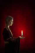 Plaited Posters - Medieval Tudor Woman Holding A Candle In Profile Poster by Lee Avison
