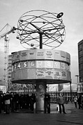 Berlin Art - meeting place at the world clock Weltzeituhr at Alexanderplatz with reconstruction work in background east Berlin Germany by Joe Fox