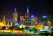 Dark Night Rises Prints - Melbourne city skyline - Skyscapers and lights Print by David Hill