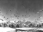 Korean War Photos - Men And Equipment Being Parachuted by Stocktrek Images