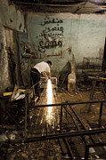 Dray Van Beeck - Metal worker at work in...