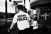 Police Officer Framed Prints - metro police bicycle cops in downtown Las Vegas Nevada USA Framed Print by Joe Fox