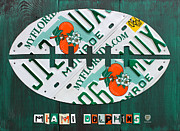 Sports Art Mixed Media Framed Prints - Miami Dolphins Football Recycled License Plate Art Framed Print by Design Turnpike