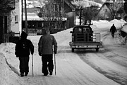 Snow Covered Village Prints - Middle Aged Couple Walking Along Snow Covered Street With Sticks Kirkenes Finnmark Norway Europe Print by Joe Fox