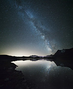Milky Way Photos - Milky way reflected in alpine lake Italy by Matteo Colombo