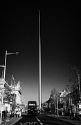 Erection Prints - millennium needle spire of dublin monument of light and dublin bus in road in OConnell Street Dublin Print by Joe Fox