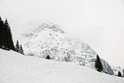 Snow-covered Landscape Photo Prints - Minimalist snow landscape - mountain and trees in winter Print by Matthias Hauser