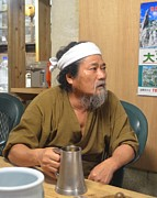 Long Bed Posters - Miyagi Minshuku Owner with Okinawan Awamori Poster by Jeff at JSJ Photography