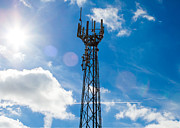 Broadcast Antenna Acrylic Prints - Mobile phone mast with a blue sky behind Acrylic Print by Fizzy Image