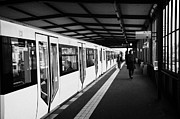 Bahn Prints - modern yellow u-bahn train sitting at station platform Berlin Germany Print by Joe Fox