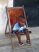 Mombasa Framed Prints - Mombasa Child In Chair Framed Print by Jay Milo