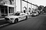 Patrol Car Acrylic Prints - Monroe County Sheriff And Key West Police Patrol Squad Car Key West Florida Usa Acrylic Print by Joe Fox