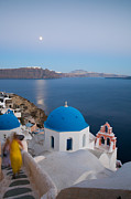 Greek Icon Photo Posters - Moon over blue domed church in Oia Santorini Greece Poster by Matteo Colombo