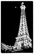 Las Vegas Artist Framed Prints - Moon Over the Paris Framed Print by John Rizzuto