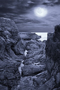Sea Moon Full Moon Posters - Moonlight over Rugged Seaside Rocks Poster by Jane McIlroy