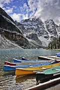 Snow Photos - Moraine Lake Canoes by Jack Booth
