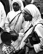 Mother Teresa With Young Boy Print by Retro Images Archive
